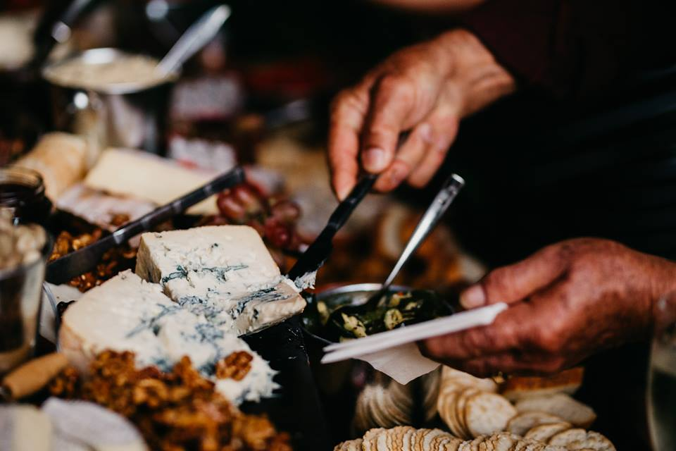 man eating from grazing board available for catering at tapasman